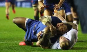 France's Virimi Vakatawa scores a try despite Stuart Hogg's intervention