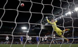 Hugo Lloris dives but is unable to stop Eden Hazard scoring the equalising goal against Tottenham Hotspur to end their title hopes.