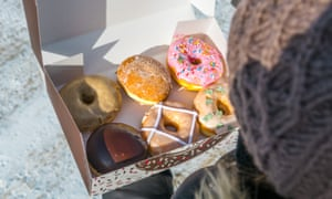 Close-Up High Angle View Of Woman Holding Various Donuts In BoxPhoto Taken In Canada, Winnipeg