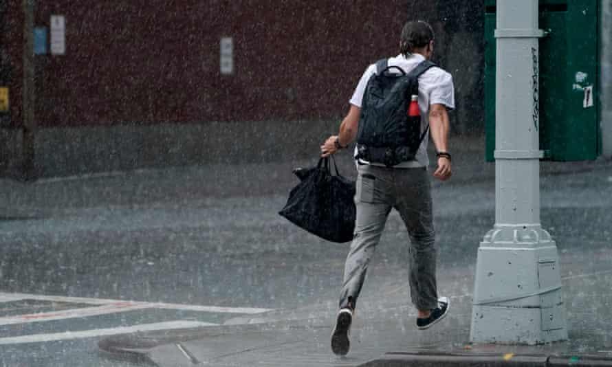 A man runs through the rain in the Chelsea area of New York on Thursday.