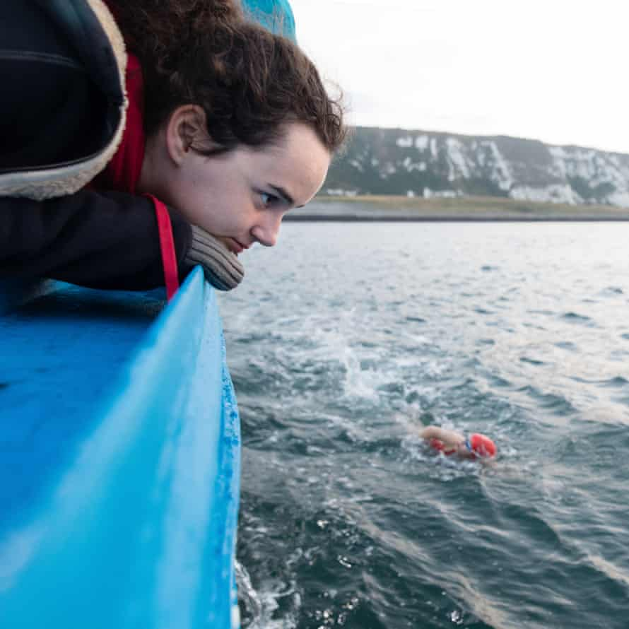 Eve looks out from the boat as Lucy swims the first leg