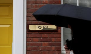 A logo hangs on the wall outside the WPP offices in London,