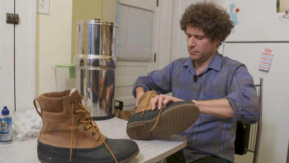Tom Perkins swabs his shoes so samples can be tested for PFAS.