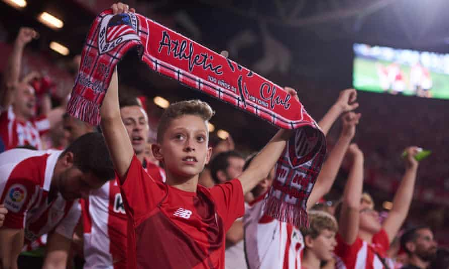 A young Athletic fan watches his side host Real Madrid at the San Mamés stadium in Bilbao.