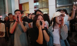 Protesters shout at riot police as they try to disperse an anti-government rally in Mong Kok, Hong Kong.