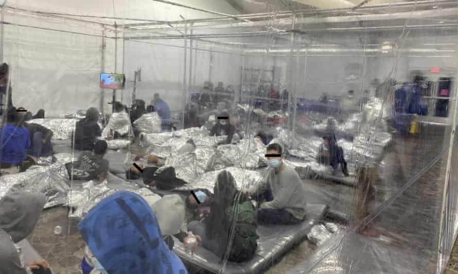 Migrants in a crowded room with walls of plastic sheeting in Donna, Texas, in a photo released 22 March. Henry Cuellar said more than 400 male minors were being held in a section meant for 250.