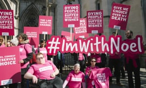 Campaigners from Dignity In Dying and supporters of Noel Conway, who was challenging the law on assisted dying, outside the Royal Courts of Justice in London on 1 May 2018.