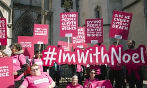 Campaigners challenging the law on assisted dying outside the royal courts on 1 May 2018 in London.