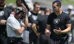 Jon Gruden talks with quarterback Derek Carr, who has failed to come back from a drop in form this season
