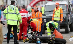 Emergency services personnel assist after a motorcycle crash at the Wales Rally GB event in Llandudno.