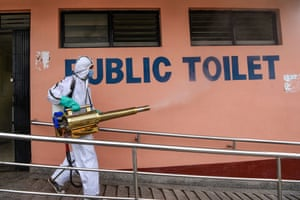 A worker sanitises public toilets at a bus station as the government eases restrictions on long-distance public transportation in Kathmandu, Nepal.