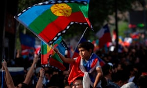 A child waves a Mapuche indigenous flag during a protest march in Santiago on Friday.