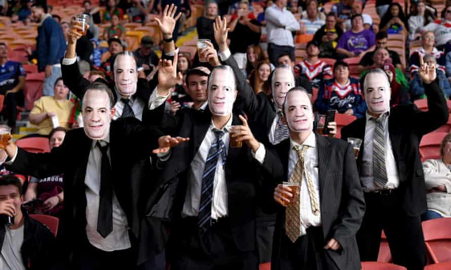 Fans sporting Peter V'landys masks