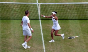 Henri Kontinen and Heather Watson celebrate their victory in the mixed doubles final.