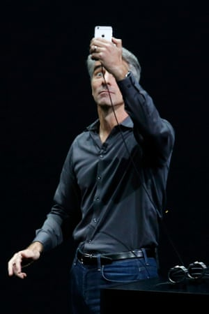 Apple executive Craig Federighi demonstrates taking selfies on a new iPhone