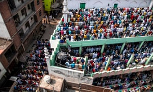 Muslims in the Mustafabad area of Delhi offer Friday prayers at a mosque following sectarian riots over India's new citizenship law.