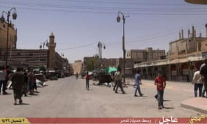 A video made available by Jihadist media outlet Welayat Homs allegedly shows people walking in a street of Syria's ancient city of Palmyra after the Isis fighters took control of the city after launching offensive less than a week ago.