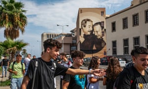 Students of the Istituto Nautico Gioeni-Trabia, in Palermo, Italy, in front of a mural of the judges Giovanni Falcone and Paolo Borsellino, killed by the mafia.