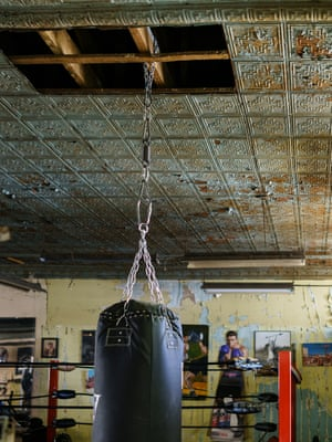 The punchbag hangs from a traditional tin plate ceiling