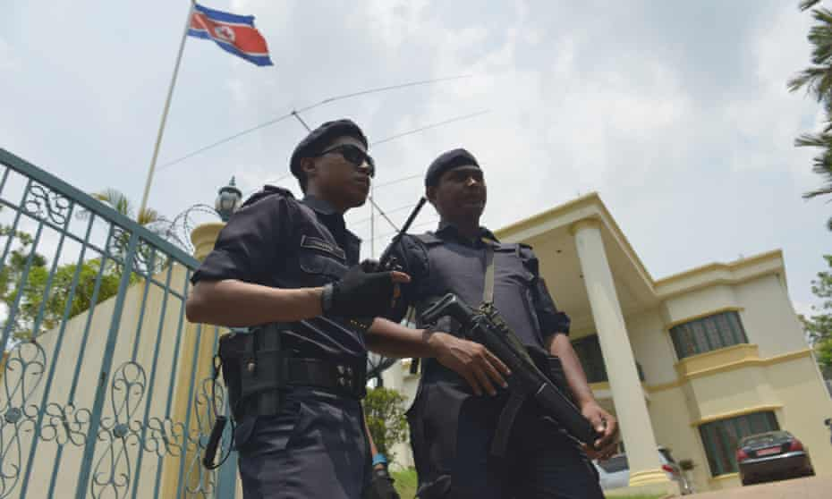 Malaysian police stand guard in front of the North Korean embassy in Kuala Lumpur. Suspects in the killing of Kim Jong-nam are believed to be inside.