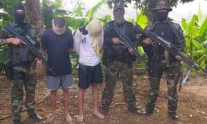 """Venezuelan soldiers parade two alleged """"mercenaries"""" captured on Friday"""