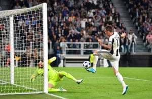 Mario Mandzukic shoots past Subasic into the roof of the net.