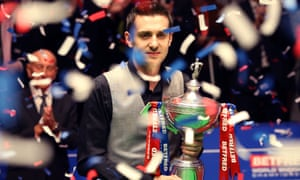 Mark Selby holds the World Championship trophy at The Crucible after beating Ding Junhui.