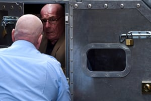 Former detective Roger Rogerson is escorted to a prison van at the Supreme Court in Sydney. Rogerson was found guilty of the murder of Jamie Gao during a drug deal at a storage unit in Sydney in May 2014.