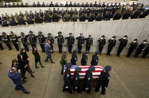 California, USFamily members follow the coffin of police officer Natalie Corona prior to a funeral service for her at the University of California.Police say Kevin Douglas Limbaugh cycled up to the policewoman while she attended the scene of a traffic incident and shot and killed her.