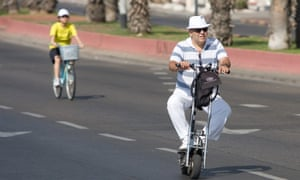 A man rides an electric scooter in Tel Aviv, Israel.