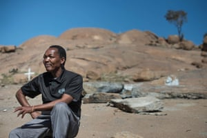 Chris Molebatse, a community leader in Marikana, sits at the small hill where the 34 miners were gunned down