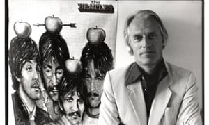 George Martin posing with a poster of Beatles in Belgium