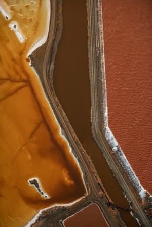 Aerial photo of yellow and orange ponds