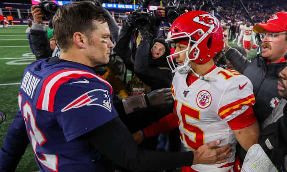 Tom Brady and Patrick Mahomes greet each other after a playoff game in January 2019