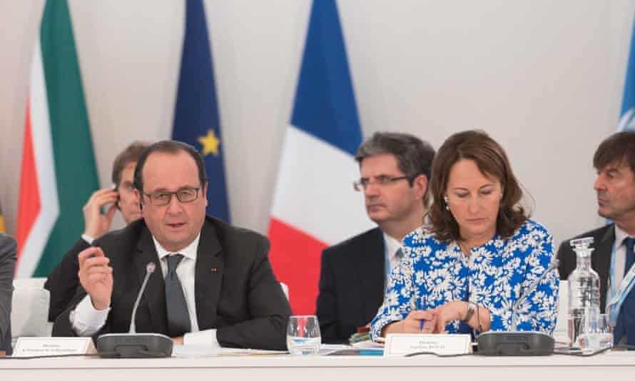 Francois Hollande and environment minister Segolene (right) announces funds for Africa to install clean energy and battle desertification.