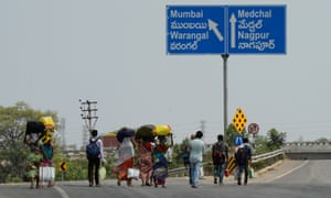 Migrant workers from the Indian state of Maharashtra walk along a highway to reach their home towns during a government-imposed nationwide lockdown as a preventive measure against the Covid-19 outbreak.