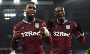 Jonathan Kodjia, left, celebrates his equaliser with Aston Villa teammate Tammy Abraham.