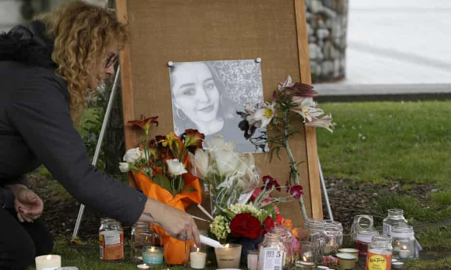 A woman lights candles during a Christchurch vigil for Grace Millane in 2018