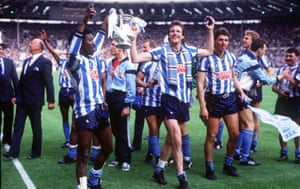 Dave Bennett and Keith Houchen - two of Coventry's goalscorers - hold the trophy as they parade round the pitch on the Sky Blues' well deserved lap of honour.