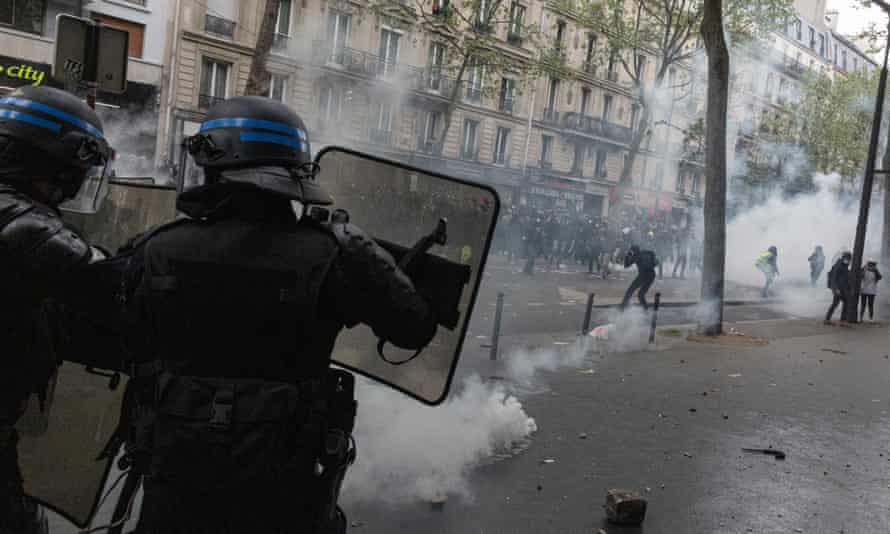 Police fire teargas at protesters in Paris, France.