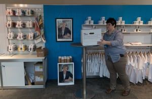 A portrait of Theresa May is displayed alongside party merchandise on sale at the Conservative conference in Birmingham