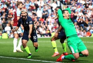 Sergio Aguero of Manchester City celebrates after scoring the winning goal as Tom Heaton of Burnley reacts at Turf Moor, helping City to win the match and move back to the top of the league.
