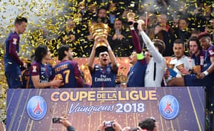 Man of the match Kylian Mbappé lifts the Coupe de la Ligue trophy after PSG's 3-0 win over Monaco.