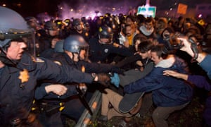 California Highway Patrol officers clash with protesters in Oakland, California