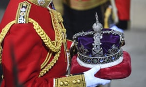 The Imperial State Crown being carried through the Sovereign's entrance for the state opening of parliament.