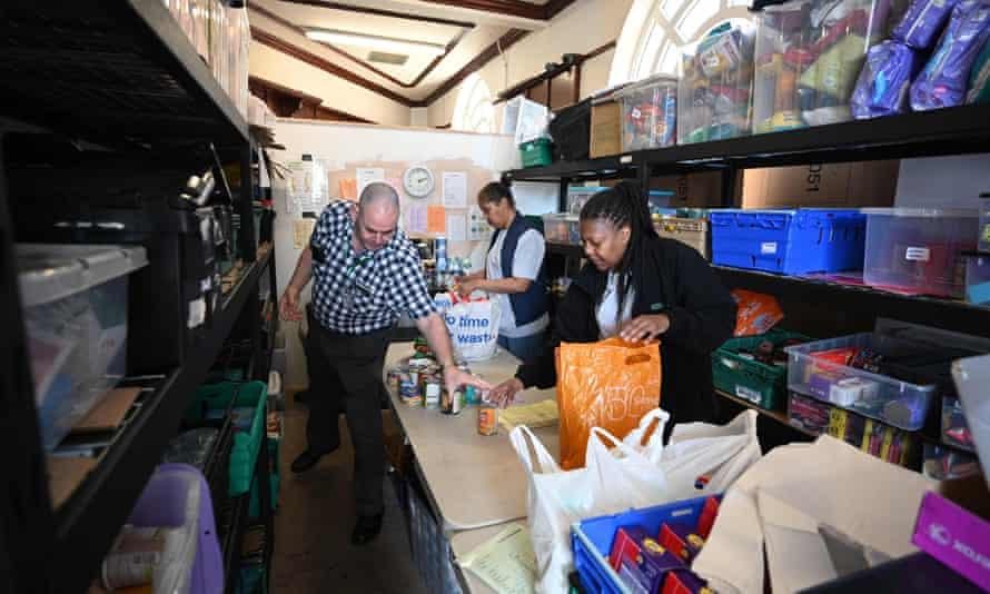 Volunteers pack food inside a Trussell Trust food bank in Oldham.