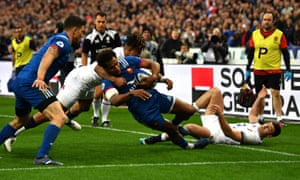 The France winger Benjamin Fall is fouled by England's Anthony Watson on the try line. Watson was sent to the sin-bin and a penalty try awarded.