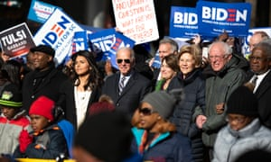 Jaime Harrison with presidential candidates Tulsi Gabbard, Joe Biden, Amy Klobuchar, Elizabeth Warren and Bernie Sanders in Columbia, South Carolina.