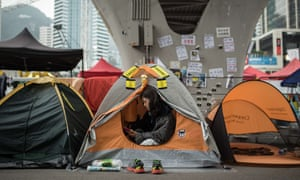 A pro-democracy protester uses her phone in her tent at the Occupy movement's main protest site in Hong Kong, December 2014.