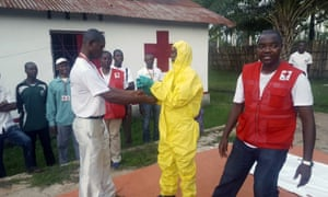 A member of a Red Cross team puts on protective clothing at a medical centre in Mbandaka, DRC